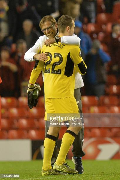 Liverpool manager Jurgen Klopp and Simon Mignolet embrace at the end of the game