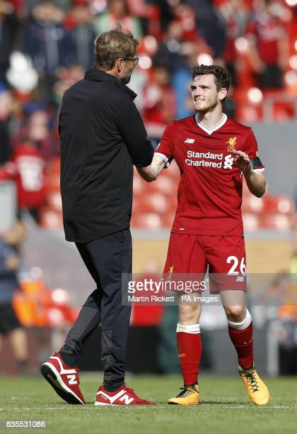 Liverpool manager Jurgen Klopp celebrates with Andrew Robertson after the Premier League match at Anfield Liverpool