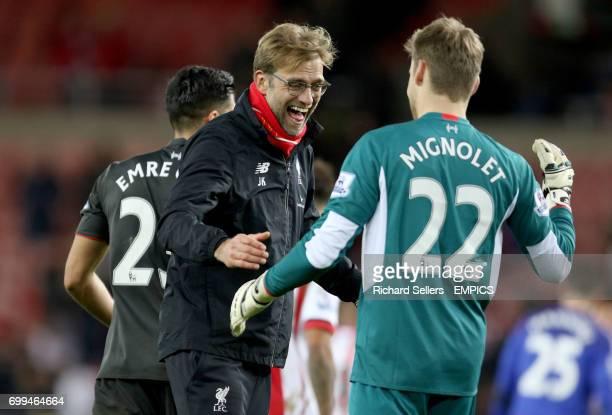 Liverpool manager Jurgen Klopp celebrates with Liverpool goalkeeper Simon Mignolet