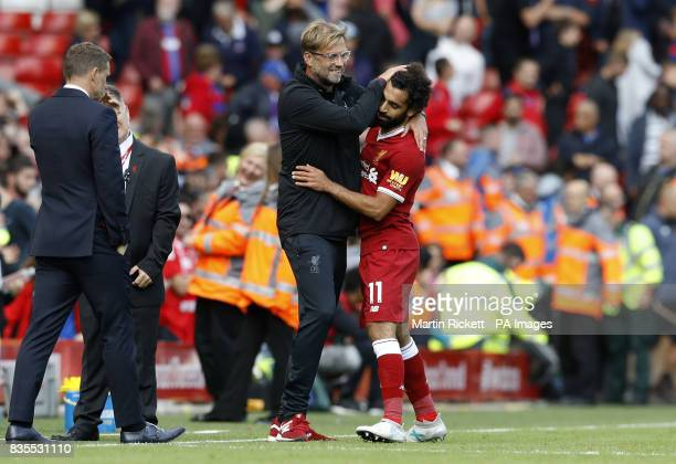 Liverpool manager Jurgen Klopp celebrates with Mohamed Salah after the Premier League match at Anfield Liverpool