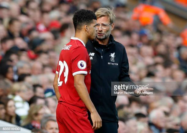 Liverpool manager Jurgen Klopp speaks with Dominic Solanke before he is subbed on during the Premier League match at Anfield Liverpool