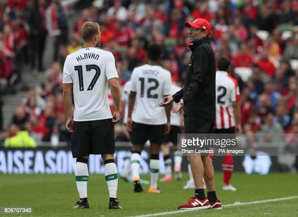 Liverpool manager Jurgen Klopp speaks with Ragnar Klavan during the preseason friendly match at the Aviva Stadium Dublin
