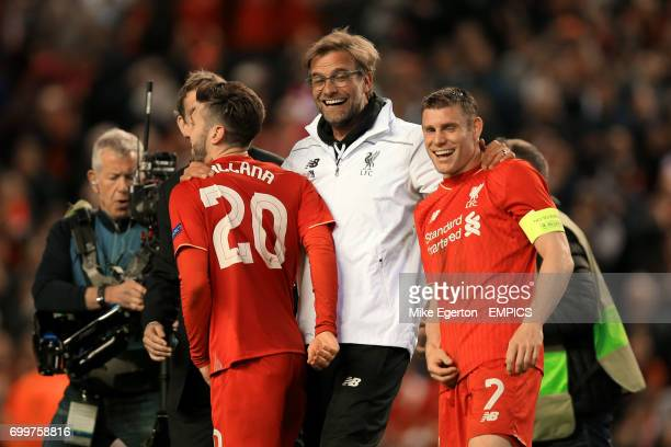 Liverpool manager Jurgen Klopp with Adam Lallana and James Milner after the final whistle