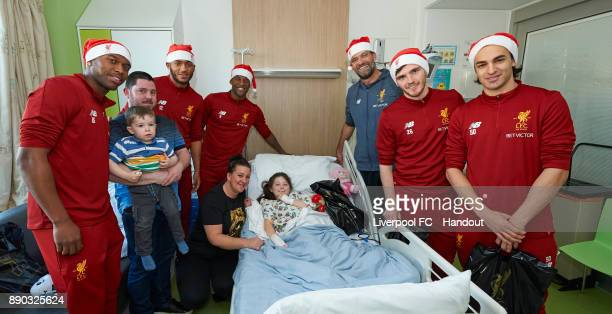 Liverpool manager Jurgen Klopp with players Daniel Sturridge Joe Gomez Georginio Wijnaldum Andrew Robertson and Lazar Markovic making their annual...