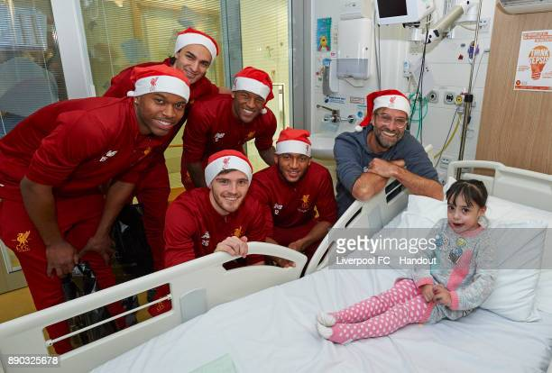 Liverpool manager Jurgen Klopp with players Daniel Sturridge Lazar Markovic Andrew Robertson Georginio Wijnaldum and Joe Gomez making their annual...