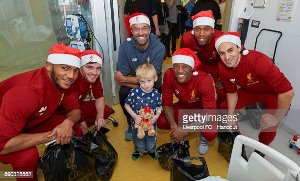 Liverpool manager Jurgen Klopp with players Joe Gomez Andrew Robertson Georginio Wijnaldum Daniel Sturridge and Lazar Markovic making their annual...