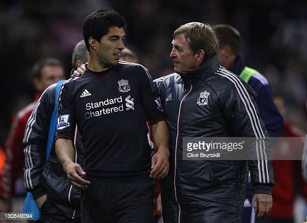 Liverpool manager Kenny Dalglish congratulates his double goal scorer Luis Suarez at end of the match during the Carling Cup Fourth Round match...