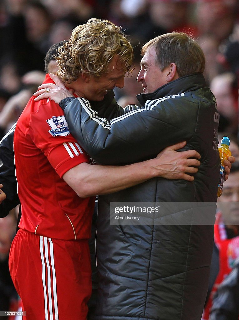 Liverpool Manager <a gi-track='captionPersonalityLinkClicked' href=/galleries/search?phrase=Kenny+Dalglish&family=editorial&specificpeople=221580 ng-click='$event.stopPropagation()'>Kenny Dalglish</a> embraces <a gi-track='captionPersonalityLinkClicked' href=/galleries/search?phrase=Dirk+Kuyt&family=editorial&specificpeople=538141 ng-click='$event.stopPropagation()'>Dirk Kuyt</a> at the end of the FA Cup Fourth Round match between Liverpool and Manchester United at Anfield on January 28, 2012 in Liverpool, England.