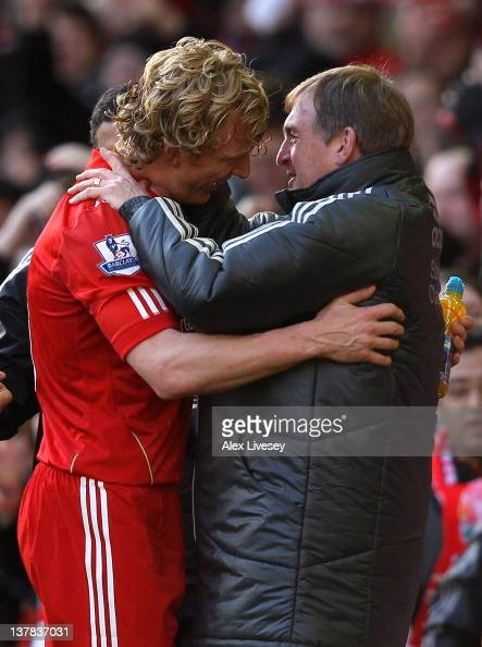 Liverpool Manager Kenny Dalglish embraces Dirk Kuyt at the end of the FA Cup Fourth Round match between Liverpool and Manchester United at Anfield on...