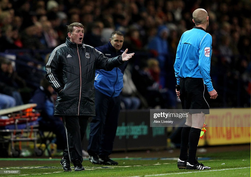 Liverpool Manager <a gi-track='captionPersonalityLinkClicked' href=/galleries/search?phrase=Kenny+Dalglish&family=editorial&specificpeople=221580 ng-click='$event.stopPropagation()'>Kenny Dalglish</a> protests to the Assistant Referee during the Barclays Premier League match between Bolton Wanderers and Liverpool at the Reebok Stadium on January 21, 2012 in Bolton, England.