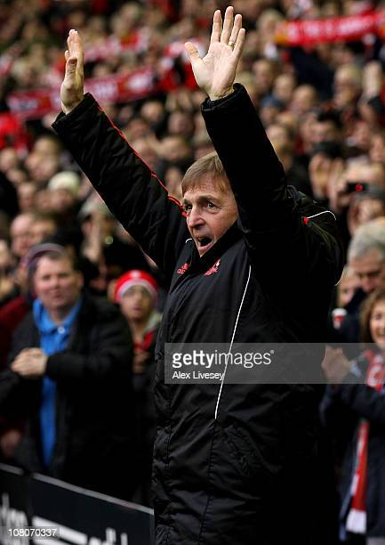 Liverpool Manager Kenny Dalglish salutes the fans prior to the Barclays Premier League match between Liverpool and Everton at Anfield on January 16...