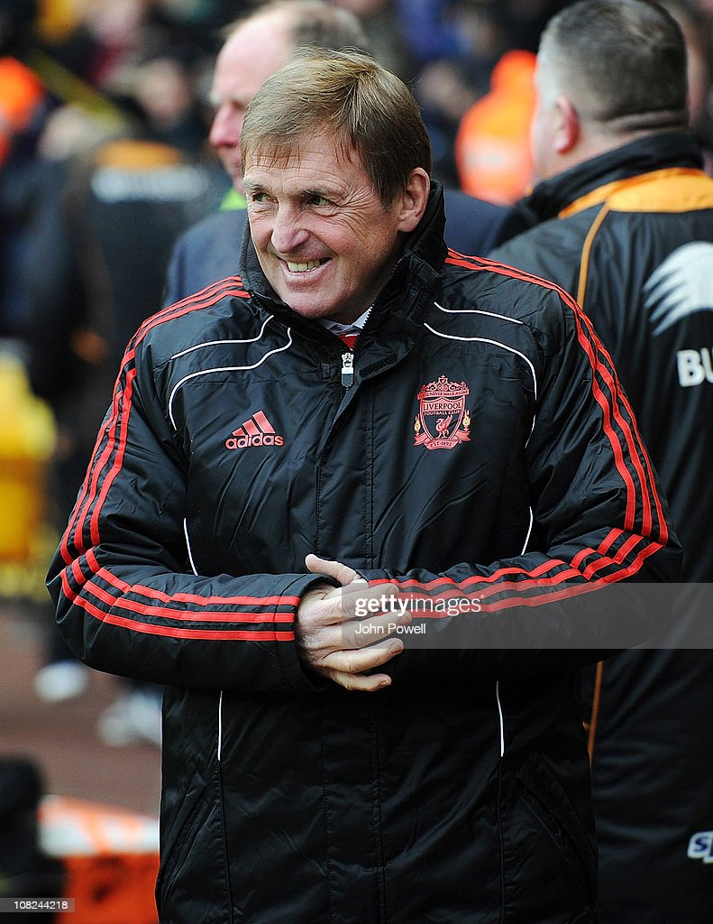 Liverpool manager <a gi-track='captionPersonalityLinkClicked' href=/galleries/search?phrase=Kenny+Dalglish&family=editorial&specificpeople=221580 ng-click='$event.stopPropagation()'>Kenny Dalglish</a> smiles during the Barclays Premier League match between Wolverhampton Wanderers and Liverpool at Molineux on January 22, 2011 in Wolverhampton, England.