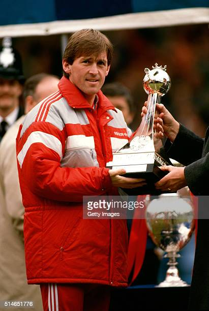 Liverpool manager Kenny Dalglish with the trophy at the presentation of the Barclays Division One title before the match against Southampton at...