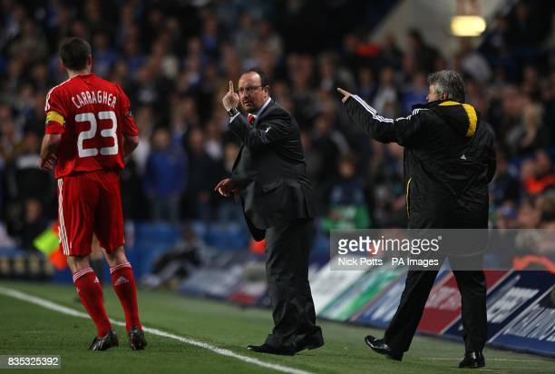 Liverpool manager Rafael Benitez gives directions to his captain Jamie Carragher as Chelsea manager Guus Hiddink directs his players from the...