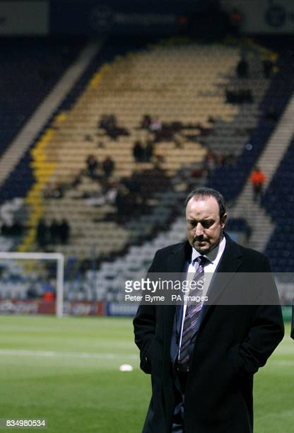 Liverpool manager Rafael Benitez walks on the pitch before the match with a mosaic of Liverpool and Preston North End legend Bill Shankly visible in...