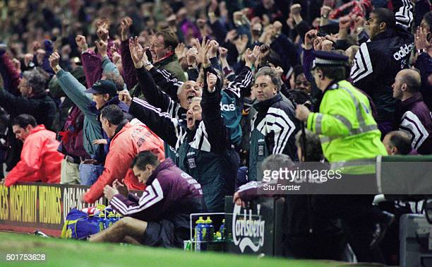 Liverpool manager Roy Evans and coach Ronnie Moran celebrate Stan Collymore's stoppage time winner as Newcastle player Steve Howey and management duo...
