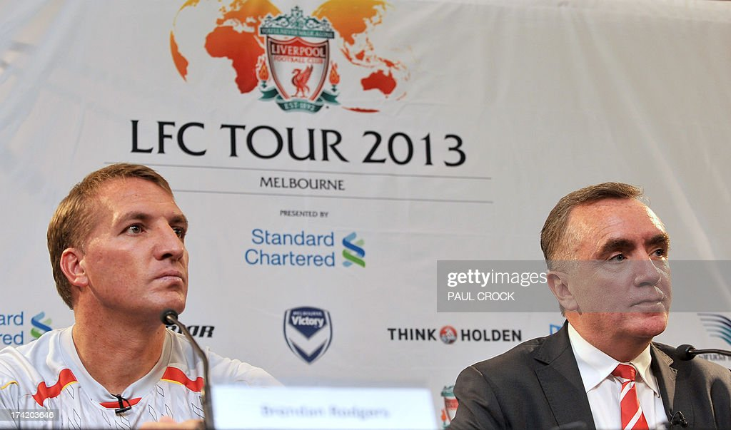 Liverpool Managing Director Ian Ayre (R) and team manager Brendan Rogers (L) listen to a question at a press conference in Melbourne on July 22, 2013. Rodgers said on July 22 he expects unsettled star Luis Suarez to stay with the club after the Uruguay striker arrived in Australia to join his teammates in 'great spirits'. AFP PHOTO / Paul CROCK