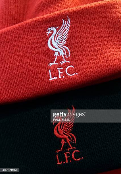 Liverpool merchandise is on sale on the approach to the stadium ahead of the UEFA Champions League group B football match between Liverpool and Real...