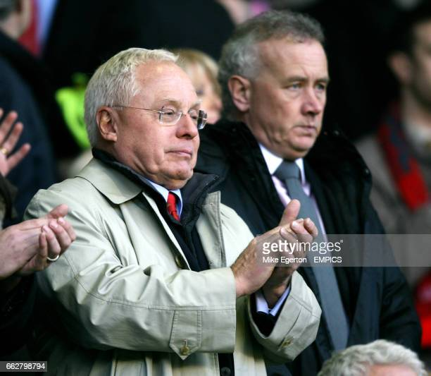 Liverpool owner George Gillett and chief executive Rick Parry watch from the stand