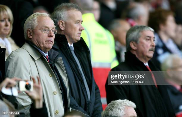 Liverpool owner George Gillett chief executive Rick Parry chairman David Moores watch from the stands
