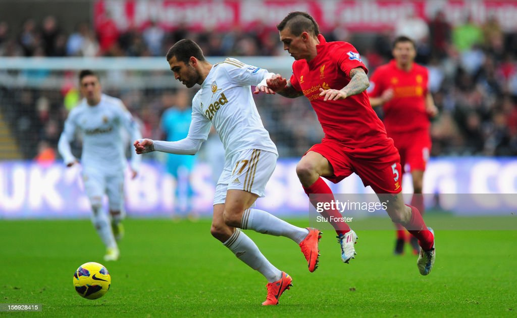 Liverpool player <a gi-track='captionPersonalityLinkClicked' href=/galleries/search?phrase=Daniel+Agger&family=editorial&specificpeople=605441 ng-click='$event.stopPropagation()'>Daniel Agger</a> (r) challenges Swansea player <a gi-track='captionPersonalityLinkClicked' href=/galleries/search?phrase=Itay+Shechter&family=editorial&specificpeople=5639928 ng-click='$event.stopPropagation()'>Itay Shechter</a> during the Barclays Premier League match between Swansea City and Liverpool at Liberty Stadium on November 25, 2012 in Swansea, Wales.