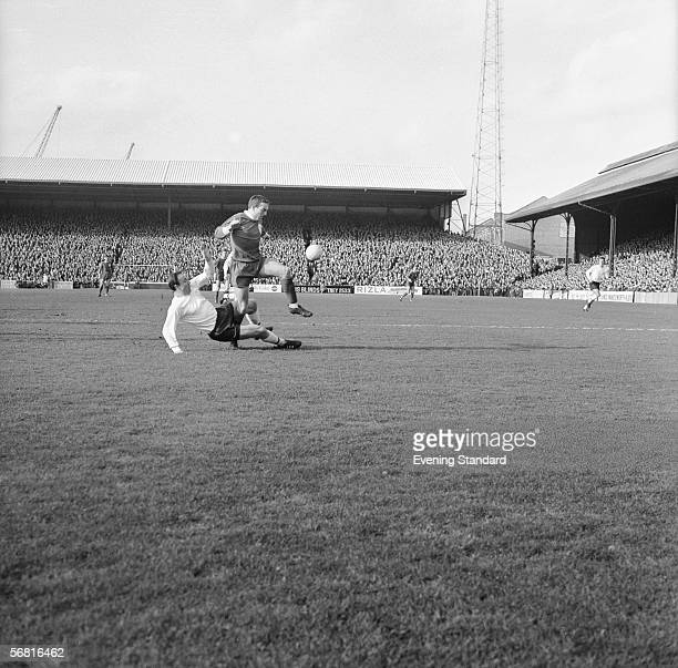 Liverpool player Ian St John escapes a two footed tackle from Fulham's right back George Cohen during a game at Craven Cottage 26th February 1966...