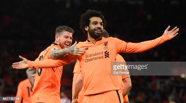 Liverpool player Mohamed Salah celebrates his second goal with Alberto Moreno during the Premier League match between Stoke City and Liverpool at...