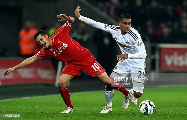 Liverpool player Philippe Coutinho is challenged by Kyle Naughton of Swansea during the Barclays Premiership match between Swansea City and Liverpool...