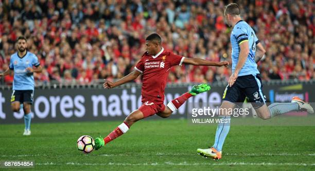 Liverpool player Rhian Brewster shoots on goal as Sydney FC player Sebastian Ryall looks on during their endofseason friendly football match at the...
