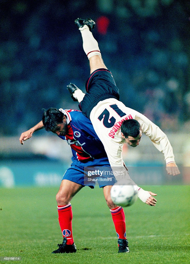 Liverpool player Steve Harkness (r) is challenged by Leonardo of PSG during a European Cup Wwinners Cup Semi Final between Paris St Germain and Liverpool at Parc Des Princes on April 10, 1997 in Paris, France.