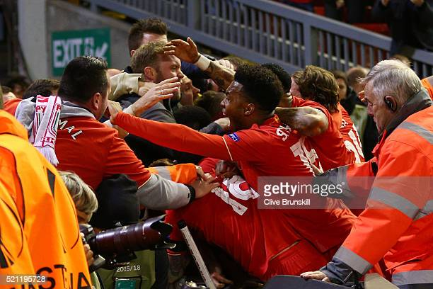 Liverpool players and fans mob Dejan Lovren of Liverpool after he scored their fourth goal during the UEFA Europa League quarter final second leg...