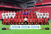 Liverpool players and staff pose for the 20142015 Liverpool FC Official Team Group at Anfield on September 18 2014 in Liverpool England Back Row...