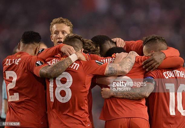 Liverpool players celebrate after winning the UEFA Europa league quarterfinal second leg football match between Liverpool and Borussia Dortmund at...