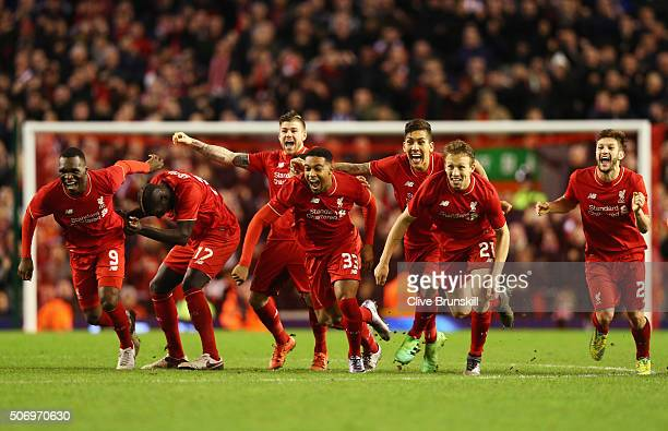 Liverpool players celebrate as Joe Allen of Liverpool scores the decisive penalty in the shoot out during the Capital One Cup semi final second leg...