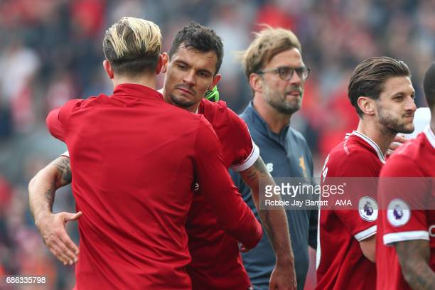 Liverpool players celebrate at full time during the Premier League match between Liverpool and Middlesbrough at Anfield on May 21 2017 in Liverpool...