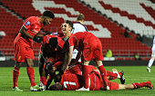 Liverpool players celebrate Daniel Cleary's goal during the UEFA Youth League fixture between Liverpool and FC Basel at Langtree Park on December 9...