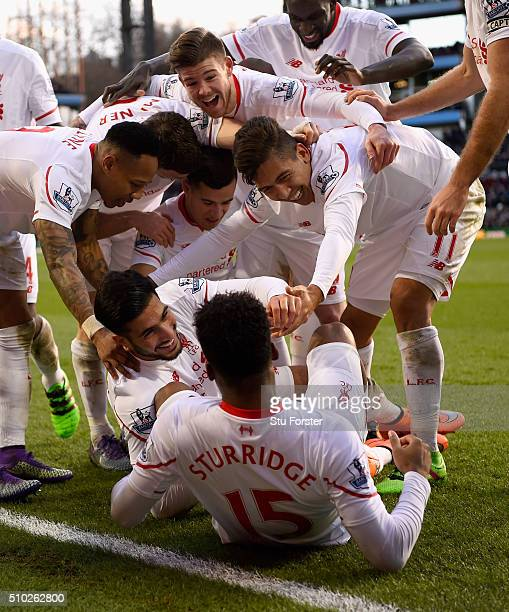 Liverpool players celebrate Emre Can of Liverpool's goal during the Barclays Premier League match between Aston Villa and Liverpool at Villa Park on...
