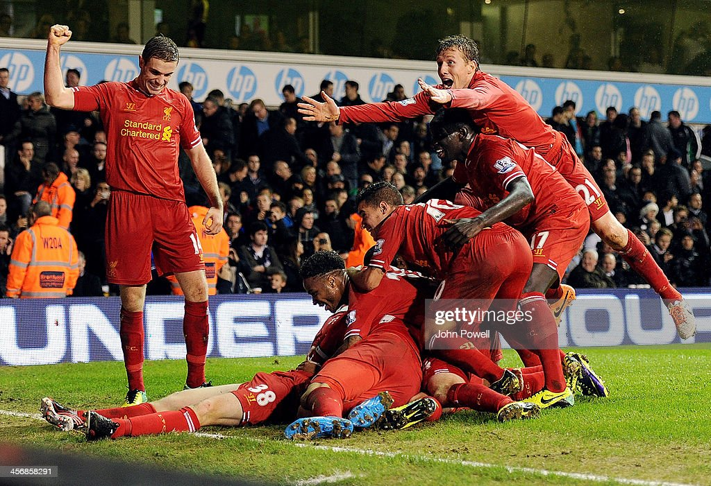 Liverpool players celebrate the goal by <a gi-track='captionPersonalityLinkClicked' href=/galleries/search?phrase=Jon+Flanagan+-+Soccer+Player+-+Born+1993&family=editorial&specificpeople=8957850 ng-click='$event.stopPropagation()'>Jon Flanagan</a> during the Barclays Premier Leauge match between Tottenham Hotspur and Liverpool at White Hart Lane on December 15, 2013 in London, England.