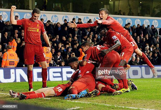 Liverpool players celebrate the goal by Jon Flanagan during the Barclays Premier Leauge match between Tottenham Hotspur and Liverpool at White Hart...