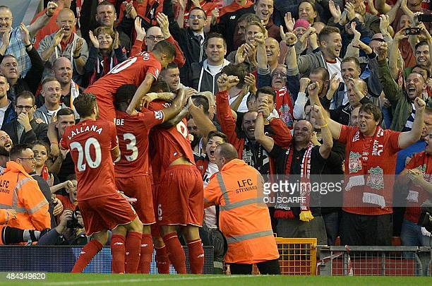 Liverpool players celebrate the goal of Christian Benteke during the English Premier League football match between Liverpool and Bournemouth at the...