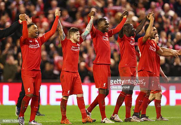 Liverpool players celebrate victory in the penalty shoot out after the Capital One Cup semi final second leg match between Liverpool and Stoke City...