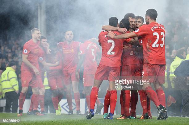 Liverpool players congratulate Liverpool's English striker Daniel Sturridge and Liverpool's Senegalese midfielder Sadio Mane after they acored the...