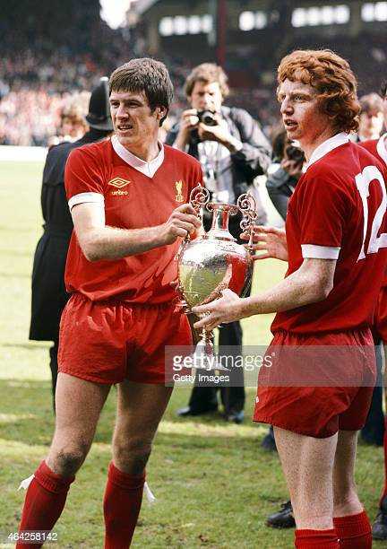 Liverpool players Emlyn Hughes and 'super sub' David Fairclough with the Football League First Division trophy for the 1976/77 season after the match...