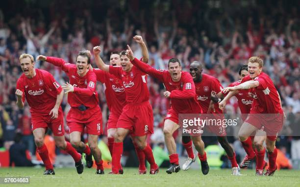 Liverpool players including captain Steven Gerrard celebrate victory at the end of the FA Cup Final match between Liverpool and West Ham United at...