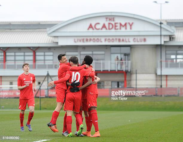 Liverpool players including Paulo Alves Adam Phillips Kane Lewis and Ovie Ejaria celebrate with goalscorer Yan Dhanda during the Liverpool v Reading...