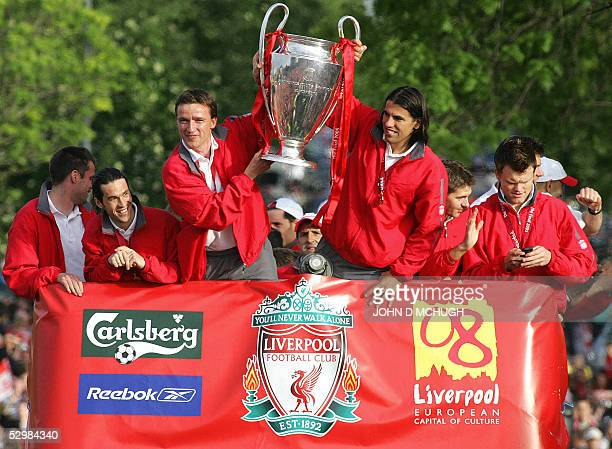 Liverpool players Jamie Carragher Luis Garcia Vladimir Smicer Milan Baros Steven Gerrard and John Arne Riise hold up the Champion's League trophy to...
