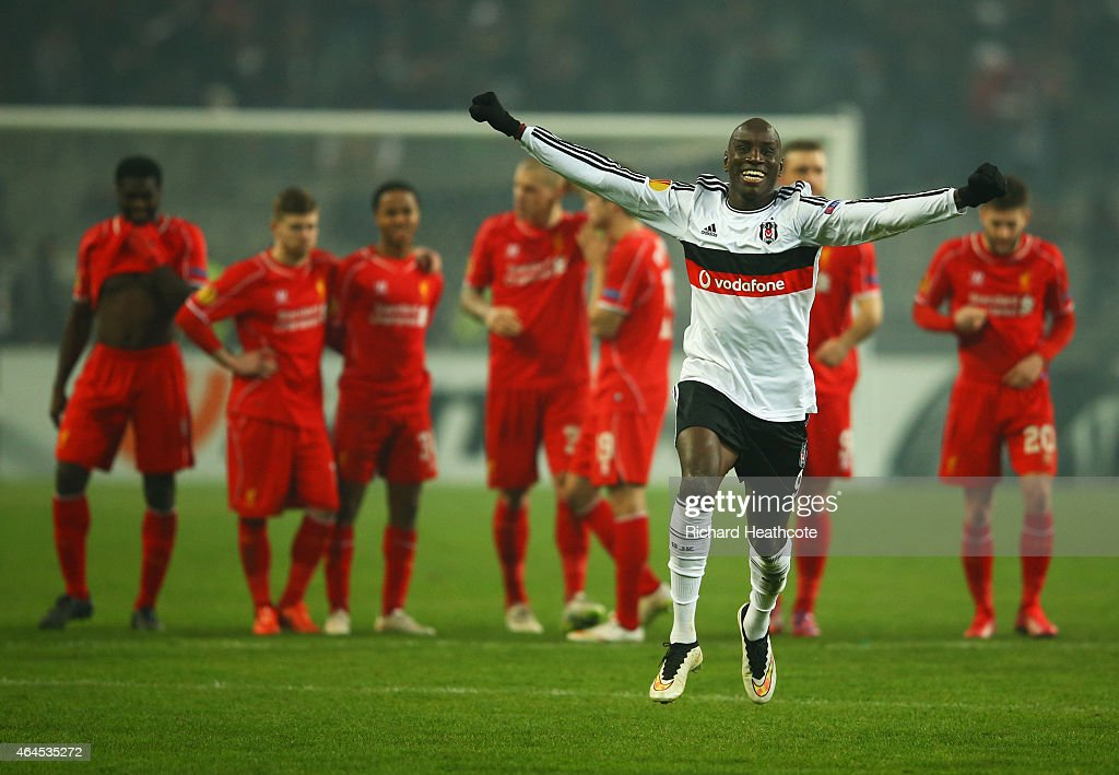 Liverpool players look dejected as <a gi-track='captionPersonalityLinkClicked' href=/galleries/search?phrase=Demba+Ba&family=editorial&specificpeople=4510297 ng-click='$event.stopPropagation()'>Demba Ba</a> of Besiktas (9) celebrates as <a gi-track='captionPersonalityLinkClicked' href=/galleries/search?phrase=Dejan+Lovren&family=editorial&specificpeople=5577379 ng-click='$event.stopPropagation()'>Dejan Lovren</a> of Liverpool misses the decisive kick in the penalty shoot out during the UEFA Europa League Round of 32 second leg match between Besiktas JK and Liverpool FC on February 26, 2015 in Istanbul, Turkey.
