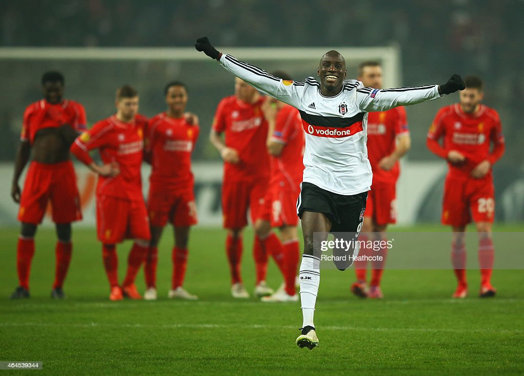Liverpool players look dejected as <a gi-track='captionPersonalityLinkClicked' href=/galleries/search?phrase=Demba+Ba&family=editorial&specificpeople=4510297 ng-click='$event.stopPropagation()'>Demba Ba</a> of Besiktas (9) celebrates as Dejan Lovren of Liverpool misses the decisive kick in the penalty shoot out during the UEFA Europa League Round of 32 second leg match between Besiktas JK and Liverpool FC on February 26, 2015 in Istanbul, Turkey.