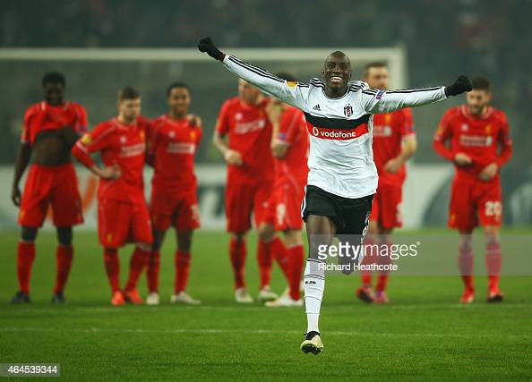 Liverpool players look dejected as Demba Ba of Besiktas celebrates as Dejan Lovren of Liverpool misses the decisive kick in the penalty shoot out...