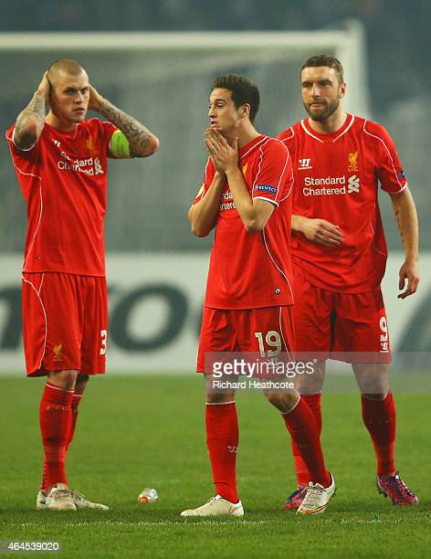 Liverpool players Martin Skrtel Javi Manquillo and Rickie Lambert look dejected as Dejan Lovren of Liverpool misses the decisive kick in the penalty...